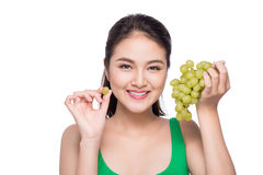 Young beautiful asian woman eating fresh grapes isolated on whit Stock Image