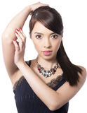 Young beautiful asian woman with flawless skin and perfect make-up and brown hair Stock Image