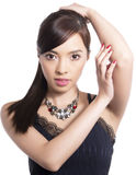 Young beautiful asian woman with flawless skin and perfect make-up and brown hair Royalty Free Stock Images