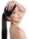Young beautiful asian woman with flawless skin and perfect make-up and brown hair Stock Photography