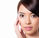 Young beautiful asian woman with flawless skin and perfect make-up and brown hair. Sexy Lipstick, highlighter and rouge on clear skin Royalty Free Stock Photography