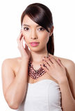 Young beautiful asian woman with flawless skin and perfect make-up and brown hair. Sexy Lipstick, highlighter and rouge on clear skin Royalty Free Stock Photo