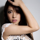 Young beautiful asian woman with flawless skin and perfect make-up and brown hair Stock Images