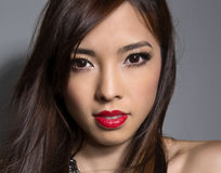 Young beautiful asian woman with flawless skin and perfect make-up and brown hair Stock Photo