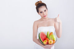 Young beautiful asian woman. With fruits on white background - Asian beauty concept Royalty Free Stock Photo