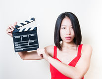 Young beautiful asian woman holding clapperboard white backgroun Stock Photography