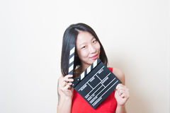 Young beautiful asian woman portrait posing with clapperboard Stock Photography