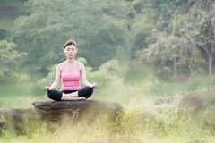 Young beautiful asian woman practicing yoga Stock Photography
