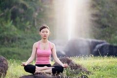 Young beautiful asian woman practicing yoga Stock Photo