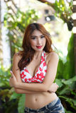 Young beautiful Asian woman in red bikini with short pants Stock Image
