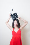 Young beautiful asian woman red dress smiling with clapperboard Stock Photos