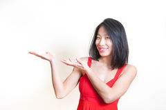 Young beautiful asian woman in red dress on white background Royalty Free Stock Photography