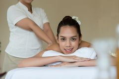 Young beautiful Asian woman relaxing in the spa massage stock image