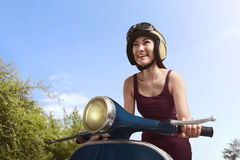 Young beautiful asian woman riding scooter Stock Photography
