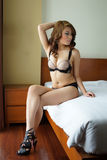 Young beautiful Asian woman in sexy lingerie Stock Images