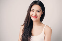 Young beautiful Asian woman with smiley face. Royalty Free Stock Image