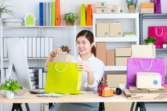 Young and beautiful Asian woman with smiling face in office. Con stock photos