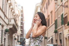 Young beautiful asian woman smiling using mobile phone spring ur Stock Photos