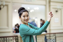 Young beautiful asian woman tourist taking pictures Stock Image