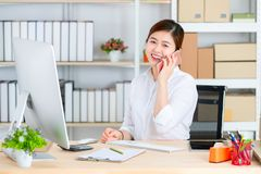 Young and beautiful Asian woman using smartphone with smiling fa stock photography