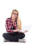 Young beautiful astonished blondie woman sitting w Stock Photography