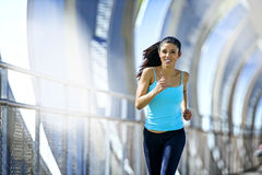 Young beautiful athletic sport woman running and jogging crossin. Young beautiful and athletic sport woman running and jogging in urban training workout crossing Stock Photography