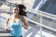 Young beautiful athletic sport woman running and jogging crossing modern metal city bridge Royalty Free Stock Photos