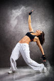 Young beautiful athletic woman dancing modern dance Royalty Free Stock Photo