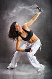 Young beautiful athletic woman dancing modern dance hip-hop Stock Photos