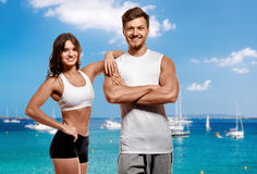 Young and beautiful athletic woman and man Stock Photos