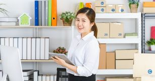 Business woman working in startup office royalty free stock photography