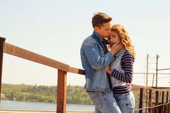 Young beautiful attractive fashion couple wearing jeans clothes Stock Photography