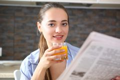 Young beautiful attractive girl in the kitchen stock image