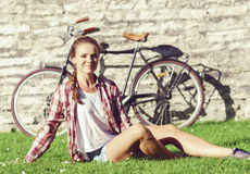 Young, beautiful attractive hipster girl relaxing in park. Holid Royalty Free Stock Image