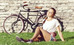 Young, beautiful attractive hipster girl relaxing in park. Holid Stock Image