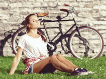 Young, beautiful attractive hipster girl relaxing in park. Holid Stock Photo