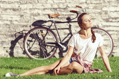 Young, beautiful attractive hipster girl relaxing in park. Holid Stock Photography
