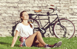 Young, beautiful attractive hipster girl relaxing in park. Holid Royalty Free Stock Photo