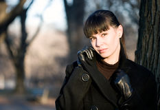 Young beautiful attractive woman in winter coat. Young beautiful attractive woman wearing black coat during winter cold season stock photography