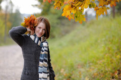 Young beautiful autumn lady. In the park Royalty Free Stock Image