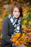 Young beautiful autumn lady. In the park Royalty Free Stock Photography