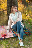 Young beautiful  in the autumn park. Stock Images