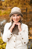 Young beautiful autumn woman in yellow park Stock Photography