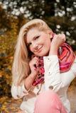Young beautiful autumn woman in yellow park Stock Photos