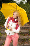 Young beautiful autumn woman with yellow umbrella Stock Photography