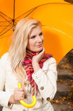 Young beautiful autumn woman with yellow umbrella Royalty Free Stock Images