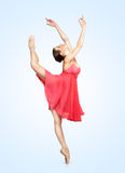 Young beautiful ballerina on a blu background Stock Photos