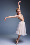 Young beautiful ballerina dancer dancing on a studio background Stock Images