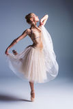 Young beautiful ballerina dancer dancing on a studio background Stock Photo