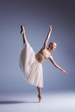 Young beautiful ballerina dancer dancing on a studio background Stock Image